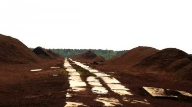 Lots of red peat heaps with  trails — 图库视频影像