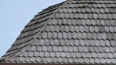 Black cedar wooden shingle roofs of a house FS700 4K — Stock Video