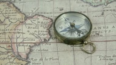 Zoom out view of the compass and the map — Stock Video