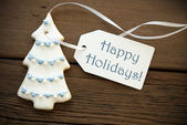 Happy Holidays on a Christmas Tree Cookie — Stock Photo