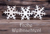 Three Snowflakes with Frohe Weihnachten — Stock Photo