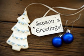 Christmas Decoration with Label with Seasons Greetings on it — Stock Photo