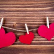 Three Hearts in different Sizes on a Line — Stock Photo #52807779