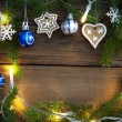 Fairy Lights and Christmas Decoration as Background on Wood — Stock Photo #52807935