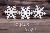 Snowflakes with Joyeux Noel — Stock Photo
