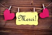 Merci on a Tag Framed By Hearts — Stock Photo