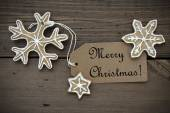 Ginger Bread Stars with Merry Christmas Label — Stock Photo