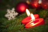 Macro of two Burning Candles with Christmas Background — Stock Photo