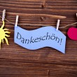 The German Word Dankeschoen on a Purple Label — Stock Photo #54730511