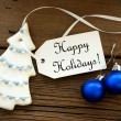 Christmas Decoration with a Label with Happy Holidays — Stock Photo #54730551