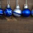 Five Decorated Christmas Balls in a Line — Stock Photo #54730693