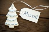 Christmas Tree Cookie with Merci Label — Stock Photo