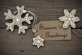 Season's Greetings on a Label with Ginger Bread Cookies — Stock Photo