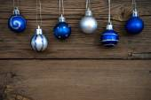 Blue and Silver Christmas Tree Balls on Wood — Stock Photo