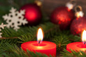 Closeup of a Candle with Christmas Decoration — Stock Photo