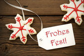 Frohes Fest on a Label with Christmas Star Cookies — Stock Photo