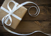 Gift With White Ribbon — Stock Photo