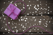 Purple Gift With Ribbon With Snowflakes — Stock Photo