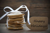 Ginger Bread Cookies with Label with Happy Holidays — Stock Photo