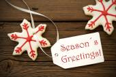 Seasons Greetings with Christmas Star Cookies — Stock Photo