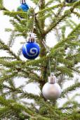 Blue and Silver Christmas Balls Hanging on a Christmas Tree — Stock Photo