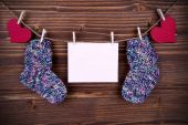 Baby Socks on a Line with Hearts and an Banner with Copy Space — Stock Photo