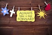 Yellow  Label Saying Always Take A Step Forward — Stock Photo