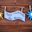 Light Blue Lable Saying Think Outside The Box — Stock Photo #58539587