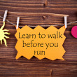 Orange Label With Life Quote Learn To Walk Before You Run — Stock Photo #60249259