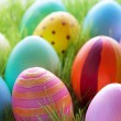 Green Grass With Many Colorful Easter Eggs For Seasons Greetings — Stock Photo #62008125