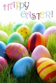 Many Colorful Easter Eggs On Green Grass With Text Happy Easter — Zdjęcie stockowe