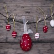 Many Red And White Easter Eggs And One Big Egg Hanging On Line Frame — Stock Photo #62636311