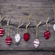 Many Red And White Easter Eggs Hanging On Line With Frame — Stock Photo #62636313