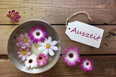 Silver Bowl With Cosmea Blossoms With German Text Auszeit — Stock Photo