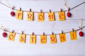 German Frohe Ostern Which Means Happy Easter Hanging On Line Four Easter Eggs — Stock Photo