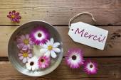 Silver Bowl With Cosmea Blossoms With Text Merci — Stock Photo