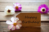 Label With Text Happy Birthday With Cosmea Blossoms — Stockfoto