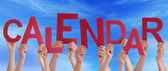 Many People Hands Holding Red Word Calendar Blue Sky — Stock Photo
