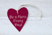 Red Heart Label With Be A Hero Every Day — Stock Photo