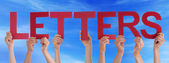Many People Hands Holding Red Straight Word Letters Blue Sky — Stock Photo