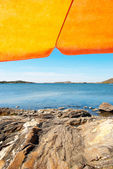 Swedish Coast With Orange Parasol And Blue Ocean — Stock Photo
