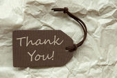 Brown Label With Thank You Paper Background — Stock Photo