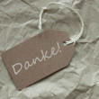 Beige Label With German Danke Means Thank You Paper Background — Stock Photo #68565261