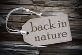 Back To Nature On Beige Label — Stock Photo