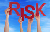 Many People Hands Holding Red Word Risk Blue Sky — Stock Photo