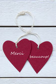 Two Hearts Label With French Merci Beaucoup Means Thank You Vert — Stock Photo