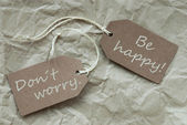 Two Beige Labels With Quote Dont Worry Happy Paper Background — Stock Photo