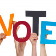 Many People Hands Holding Colorful Word Vote — Stock Photo #68942831