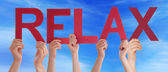 Many People Hands Holding Red Straight Word Relax Blue Sky — Stock Photo