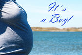 Pregnant Woman Infront Blue Sea With Text Its A Boy — Stock Photo